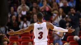 Dwyane Wade #3 of the Miami Heat reacts to the crowd during a game against the Memphis Grizzlies at American Airlines Arena on December 27, 2014 in Miami, Florida. (Source: Mike Ehrmann/Getty Images)